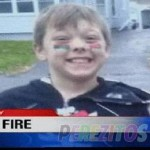 Boy who died saving his family gets firefighter's honors at funeral