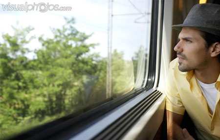 A 24 year old boy seeing out from the train's window shouted