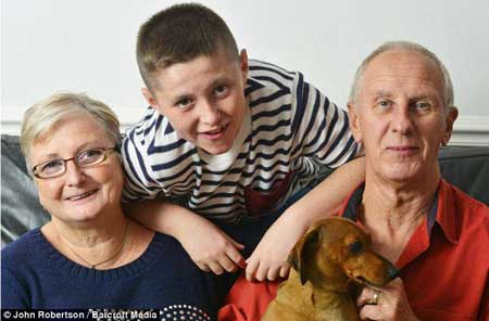 Grandparents, Debbie and Jim, posing here with Connah and their pet dog, Monty, were told to prepare for the worst when two courses of chemotherapy failed to save him