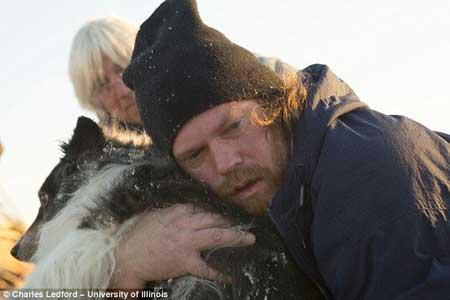 Byler Dann hugs dog