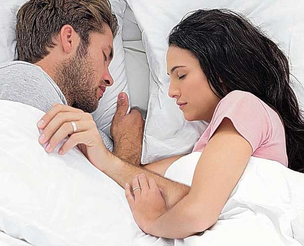 The happiest couples: Partners who sleep face to face while touching were found to be 100% satisfied in their relationships