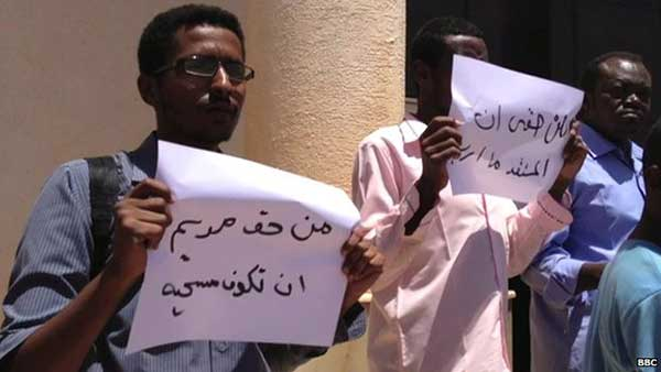 The protesters held banners that called for the right to choose any religion