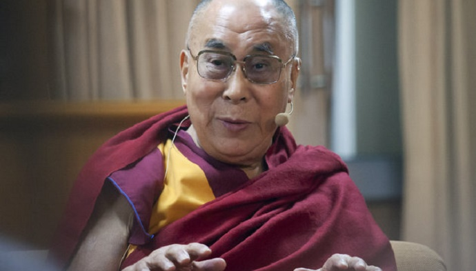 Tibetan spiritual leader the Dalai Lama speaks at a panel discussion organized by US based American Enterprise Institute (AEI) at his residence in Dharmsala, India, Wednesday, Nov. 4, 2015. The delegates spoke on the role of business in eradicating poverty. (AP Photo/Ashwini Bhatia)
